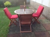 Wooden garden furniture set including table and parasol