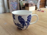 4 white and blue tea cups