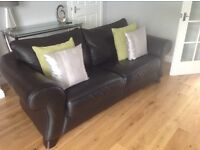 Lovely Reid's black leather sofa and footstool, perfect condition. Smoke and pet free home.