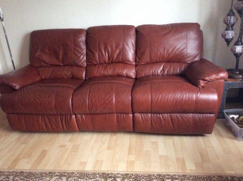Pair of tan leather sofas