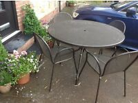 Bronze Cast Aluminium Table and 4 Stacking Chairs