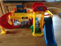 Fisher Price garage and car Shute. ( 2 items )