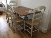 Dining table with four French style chairs