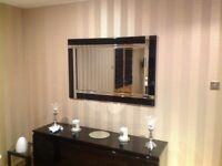Stunning black glass mirror in excellent condition