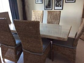 Travertine stone table and 6 wicker high back dining chairs
