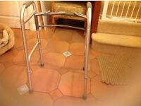 Fully adjustable folding walking frame