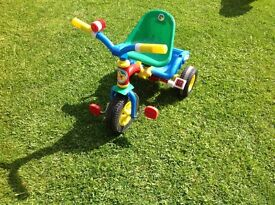 Childs trike with push a long handle
