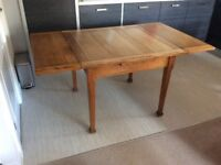 Solid oak extending dining table. 4 solid wood chairs. Maybe sold separately.