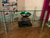 tv stand,3 glass shelves,grey legs,very heavy and would need 2 person pickup,vgc