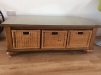 Antique pine coffee table, glass top, 3 wicker storage baskets.