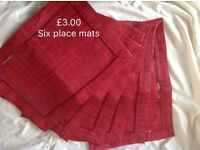Six red place mats