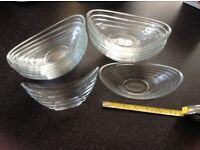 12 small glass Pyrex dessert dishes . Unusual shape, bought in France.