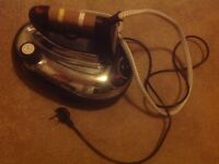 Steam generated electric iron