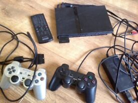 PlayStation 2 with 2 controllers PS2 and 5 games