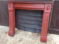 Dark wood ornate fire surround