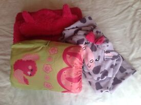 Girl's Cosy Onesies age 12 and sleeping bag bundle