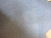Dark turquoise carpet tiles.