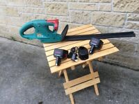 Cordless Bosch hedge trimmer, nearly new, in good working order.