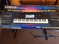 Yamaha keyboard boxed and stand