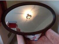 Large wooden shaped mirror...