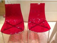"Modern ""ice"" red chairs x 2"