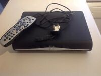 Sky box with remote and mains cable