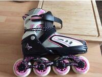 Nearly new girls rollerblades
