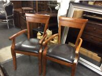 Pair of vintage mahogany chairs with arms