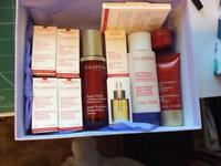 Clarins Super Serum, Body Lotion, Super Restorative Lotion and loads of samples