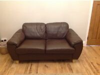 Dark brown leather sofa. Two seater Good condition