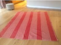 Red and natural woven, washable rug