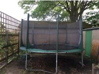 Plum 12foot trampoline with side netting and spring covers good condition
