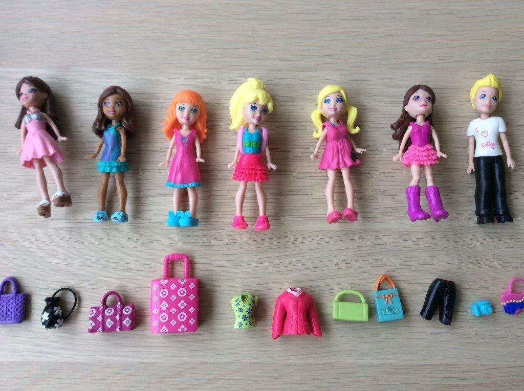 7 Polly pocket dolls