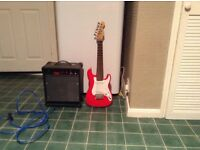 children's electric guitar and amplifier