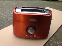 Copper coloured toaster