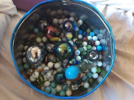 Large tin of marbles many large house of marbles ones