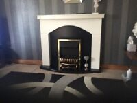 White fire surround and fire