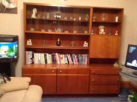 Teak wall unit with drinks cabinet and shelves and cupboards