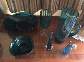 A group of decorative vintage glass pieces in a lovely deep teal blue
