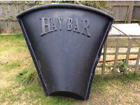 Horse stable corner hay bar