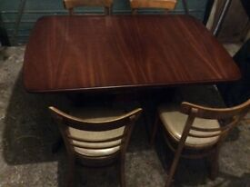 Extending leaf dining room table and 4 chairs
