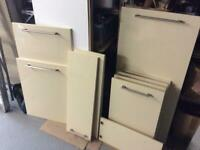 Kitchen doors/drawer fronts in gloss cream with stainless steel handles