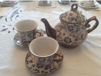 Gold and White Teapot with 2 matching cups and saucers