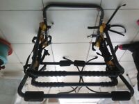 Bike carrier with rails for 2 adult bikes.