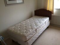 Comfortable clean single bed complete with wooden headboard