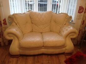 Cream Leather suite, three seater, two seater, arm chair and foot stool.