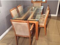 Glass topped oak veneer table and six matching seats