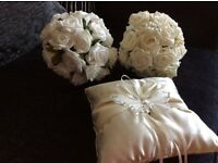 2 Ivory bridesmaid flowers and ring cushion