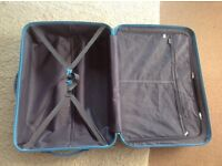 Brand new suitcase, large, hard shell, 4 new spinner wheels