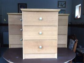 set of three matching small chests of drawers